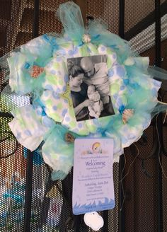 Beach theme, it's a door decor made out of dippers and shells. It was used for a welcoming baby shower using a photograph and the invitation of their shower.