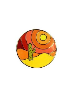 There's nothing like having a desert sunset in the palm of your hand to make your day a little more serene! - High quality enamel lapel pin - Measures 1 inch wide - Includes rubber backing By Natasha