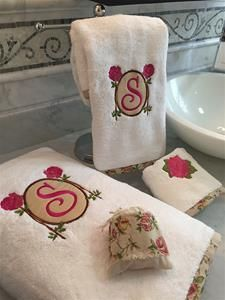 Rose Monogram Towel Set.  Soft and absorbent white towel. Feels like 100% cotton. Made of 90% cotton and 10% polyester. These towels have an edge finishing of rosy roses linen ribbon all around. They are embroidered with a fancy border of roses appliqué, where you can embroider your monogram. Wash towel embroidered with just a rose.