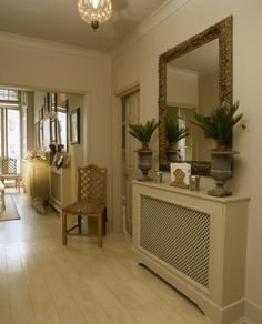 Image: Gilt mirror hanging over radiator cover in neutral open plan hallway. White Radiator Covers, Modern Radiator Cover, Open Plan Kitchen Living Room, Home Living Room, Wall Heater Cover, Victorian Radiators, Contemporary Radiators, Hallway Mirror, Townhouse Interior