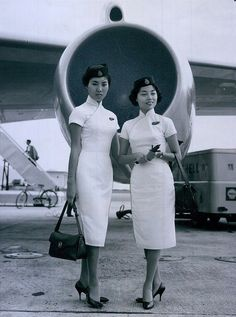 1962 Cathay Pacific Air stewardess. Kai Tak, Hong Kong.