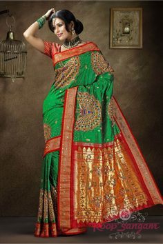 Green Paithani saree with a solid contrast border.The peacock embroidery is all over the  border side