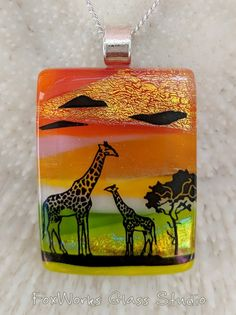 In the Scenic Pendants the vibrant and shimmering colors fuse together to form a gorgeous layered backdrop to a beautiful nature scene. The pendants are put together piece by piece from high quality dichroic and art glass. Several layers that form a colorful and dimensional background