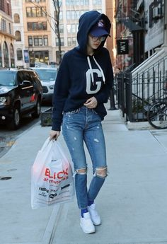 Gigi Hadid Ripped Jeans - Gigi Hadid teamed her sweater with a pair of ripped jeans.