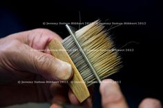 A calligraphy brush maker, working with the hairs of a brush, in the workshop in Toyohashi, Japan, Monday 18th May 2009