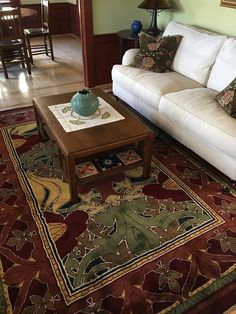 Donnemara is an iconic Donegal Carpet Company design by English architect C.F.A. Voysey. This 6x9 foot rug is in rich, bold harvest colors. It's now at home in Burlingame, CA in a house that has numerous other craftsman elements. Great choice!