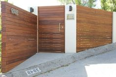 Ipe wood fence landscape modern with stucco columns stucco columns ipe fence