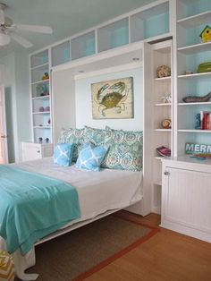 Turquoise is classic beach! Love the shelf backing painted to match the bedding accents. Come visit us at https://seasyourday.com to discover how to design a coastal & beach lifestyle...wherever you live!