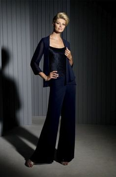 Size 12 Navy Cameron Blake Formal Pant Set with Skirt 111673- Four-piece chiffon and charmeuse pant set and skirt set, sleeveless uniquely gathered charmeuse bodice with tapered shoulder straps and scoop neckline, chiffon wide leg pants, chiffon tea-length slim A-line skirt with hand-beaded trim, matching chiffon cardigan style jacket with three-quarter length sleeves and beaded trim.