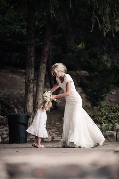Bride and flower girl dancing together