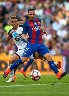 Paco Alcacer of FC Barcelona is tackled by Fernando Navarro of Deportivo de La Coruna during the La Liga match between FC Barcelona and RC Deportivo...