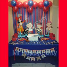 Jake and the Neverland Pirates party cake table decoration. Goodie bag, wood figure and balloon streamer backdrop. For more party ideas like us www.facebook.com/mrhappyparty