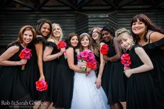 Bride and bridesmaids in black dresses. Outside the New Guesten Hall at Avoncroft Museum of Historic Buildings (avoncroft.org.uk). Rob & Sarah Gillespie Photography
