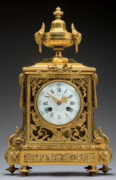 Terminal clock in ormolu dial indicating the hours in Roman numerals and Arabic numeral minute is signed by Auguste Lemaire It is decorated to the amortization of the Antique vase in the ram heads dial is surrounded by ribbon, scrolls and acanthus leaves Base jump feet tops Small   Louis XVI style, late nineteenth century   H: 44 - L: 28