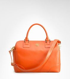 Tory Burch is genius with this tangerine handbag.