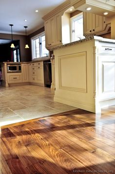 #Kitchen Floors: Perfectly smooth transition from hardwood flooring to tile floors in an open-plan kitchen.