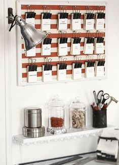Business cards hung from binder clips, via Country Home.