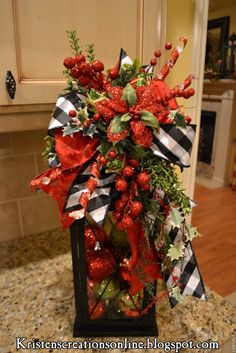 black and white ribbon combined with traditional red & green...This woman really knows how to decorate. Click on the picture and you're going to want to hire her!!!!