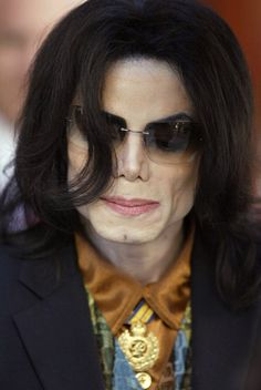 Michael Jackson Photos Photos - Michael Jackson leaves the Santa Barbara County Courthouse following testimony in his trial on child-molestation charges March 15, 2005 in Santa Maria, California. Jackson is charged in a 10-count indictment that includes molesting a boy, plying him with liquor and conspiring to commit child abduction, false imprisonment and extortion. - The Michael Jackson Trial Continues
