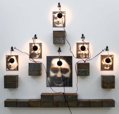 Christian Boltanski, Autel de Lycée Chases [Furnace Bridge of Chases High School], 1986-1987, Six photographs, 6 desk lamps and 22 tin boxes, 67 x 84.5 in. (170.2 x 214.6 cm)
