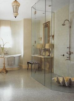 beautiful glass shower and pendant light with clam shell in shower