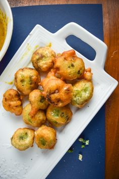 Recipe for crispy beer-battered Brussels sprouts. 3-ingredient beer batter is used to make deep fried Brussels sprouts, served with maple-mustard sauce.