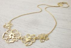 Poppies Necklace in Gold. $50.00, via Etsy.