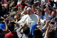 Pope Francis waves to the crowd after celebrating a Palm Sunday Mass in St. Peter's Square at the Vatican, Sunday, April 9, 2017. Pope Francis has blessed palm fronds and olive branches in St. Peter's Square at the start of Holy Week celebrations. Alessandra Tarantino AP Photo