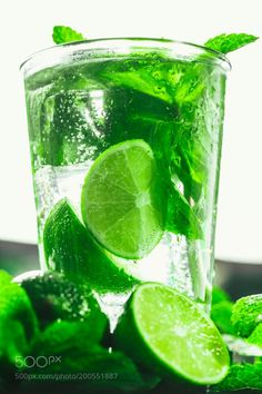 glass of mojito with lime and mint close-up ice cube on a dark background by Ruslan117  IFTTT 500px
