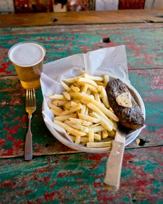 There's nothing like an ice cold draft beer to wash down a perfectly grilled steak and hand-cut sea salt fries. But I mean, you could cook dinner at home if that's what you're into. Red Fish Blue Fish, Cook Dinner, White Sand Beach, Outdoor Dining, Sea Salt, The Good Place, Fries, Steak, Good Food