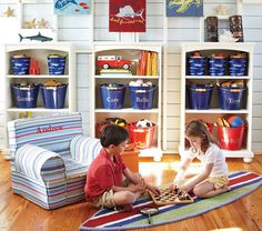 Consider BUCKETS for toy storage. Labels can be applied with a chalkboard label or a laminated photo.