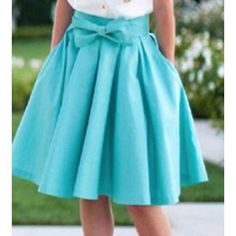 "New Blue Satin Skirt I ordered this online and it is too small for me. It has a bow on the front and a hidden zipper on the side. Fits at the waist with a flared style. Light blue. New with bag it came in. Waist: 26"", Length: 21"". Skirts A-Line or Full"