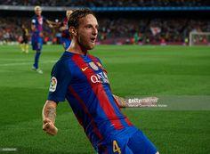 Ivan Rakitic of FC Barcelona celebrates scoring his team's first goal during the…