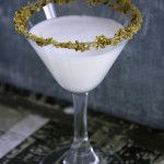 Pear Almond Crisp Martini // 4 oz pear liqueur 1.5 oz vanilla vodka .5 oz amaretto 2 oz half and half 1 t honey liqueur      Combine ingredients into a cocktail shaker filled half-way with ice. Shake for 30-40 seconds and pour into to small martini glasses rimmed with cinnamon-nutmeg sugar.  Notes For the Cinnamon-Nutmeg Sugar rimmer: Combine 1 tablespoon of dark brown sugar, a pinch of cinnamon, and a pinch of freshly grated nutmeg into a shallow bowl.
