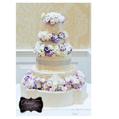 Frosted Art Bakery & Studio 5 tier fondant cake with floral elevation, piping, fresh floral, and bling in ivory.