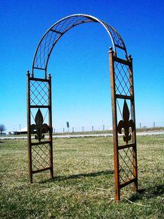 """Wrought Iron Fluer De Lis Arbor from """"A Rustic Garden"""""""