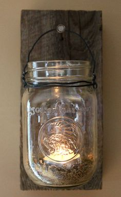 Mason jar hanging lantern by kateblais on Etsy. Probably pretty easy to make yourself Mason Jar Lanterns, Mason Jar Sconce, Hanging Mason Jars, Hanging Lanterns, Jar Candle, Mason Jar Projects, Mason Jar Crafts, Mason Jar Diy, Diy Projects