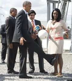President Barack Obama plays with a 'soccket' ball, a soccer ball that captures the energy during game play to charge LEDs and small batteries, alongside Tanzanian President Jakaya Kikwete (L) on July 2, 2013 during a demonstration at the Ubungo Plaza Symbion Power Plant in Dar Es Salaam, Tanzania.