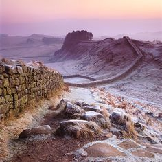 Hadrian's Wall in England was a defensive fortification in Roman Britain, begun in AD 122 during the rule of emperor Hadrian. In addition to its military role, gates through the wall served as customs posts