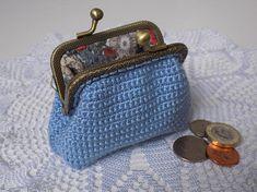 Stylish coin purse. Clasp wallet. Light blue metallic kiss lock purse.