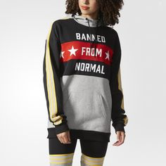 """Pop sensation and fashion icon Rita Ora brings her daring and vibrant attitude to a fresh collaboration with adidas Originals.Inspired by DIY trends, this woman's hoodie takes the British singer's boundary-pushing sense of style and combines it with a cut and sewn look. The sweatshirt flashes """"Banned from normal"""" across the front, and a large Trefoil logo decorates the back. Made with soft French terry, the modern look is finished with a high neckline."""