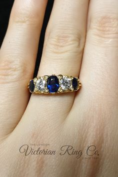 This 18ct yellow gold sapphire and diamond half hoop ring has been carved with a vintage style scroll pattern. The ring features three oval sapphires, two old-cut diamonds and 8 rose-cut diamond points. This an antique ring design that is over 150 years old. #victorianhalfhoppring #sapphirehalfhoopring #sapphirering #vintagestylering #antiqueringdesign