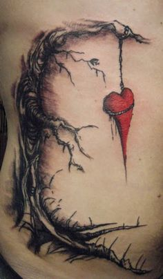 Tree tattoo hanging the heart till dead. This tree and heart tattoo on chest is the unique design for men and women.
