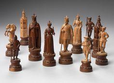 Investigaciones recientes han demostrado que estos conjuntos fueron talladas en Brieze, Suiza. Juegos de este tipo son conocidos por su fina talla, y ésta ofrece peones individualizados en diferentes poses y vestidos. El título suizo Carlomagno es una denominación creada por la comunidad de recogida de ajedrez.