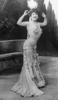 French actress posing for cameo modelling what a lady of fashion would be wearing to a soiree during the Belle Epoque.