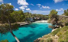 Majorca's Cala Llombards cove is a long strip of white sand along the southeast coast