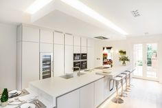 bulthaup b1 kitchen in Sand Grey matt lacquer. Miele and Gaggenau appliances. Corian worktops from Counter Production