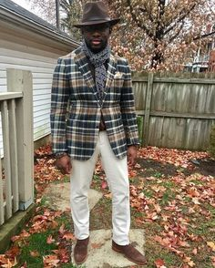Pairing an olive plaid wool suit jacket and white trousers will create a powerful and confident silhouette. For footwear go down the casual route with brown suede derby shoes.   Shop this look on Lookastic: https://lookastic.com/men/looks/blazer-dress-pants-derby-shoes/23489   — Dark Brown Wool Hat  — Navy Print Scarf  — Olive Plaid Wool Blazer  — White Dress Pants  — Brown Suede Derby Shoes