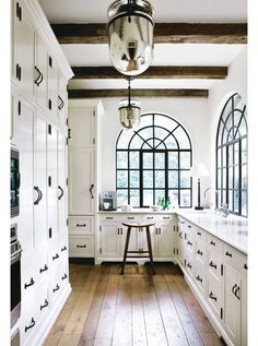 kitchen, black and white, wrought iron handles, exposed beams, rustic, black frame windows