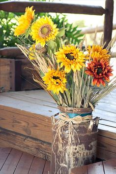 Love the sunflowers and antique butter churn!